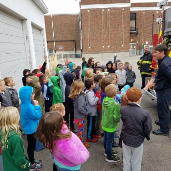 Photo of students with firefighters