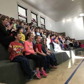 Photo of students watching performance