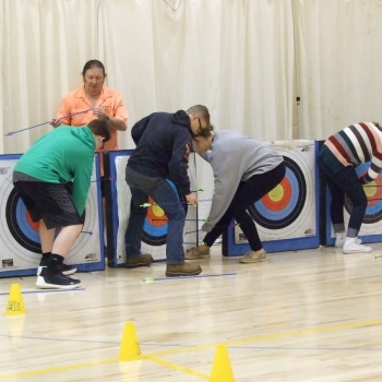 Students retrieving arrows