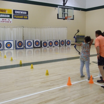 Student doing archery