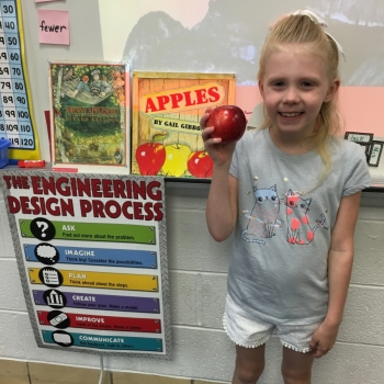 Photo of student with apples
