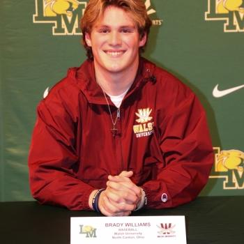 athlete smiling at his signing