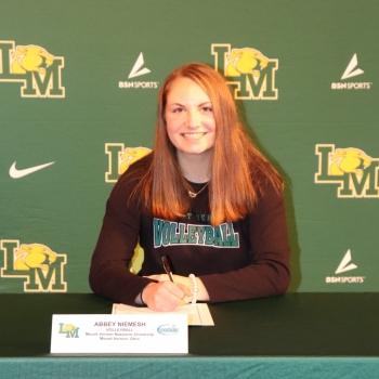 athlete smiling at her signing