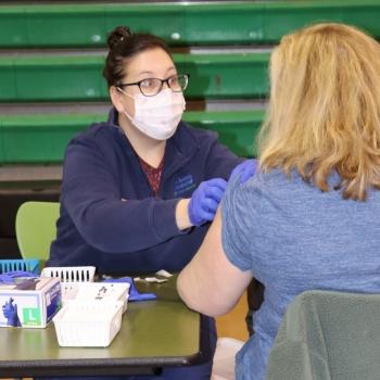 LM nurse administering COVID vaccine