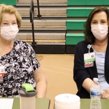 Mercy Health vaccinators smile at staff vaccination