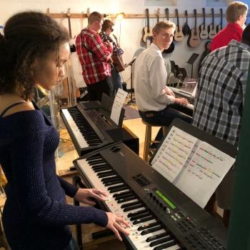photo of student playing keyboard