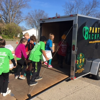 Students loading food drive items