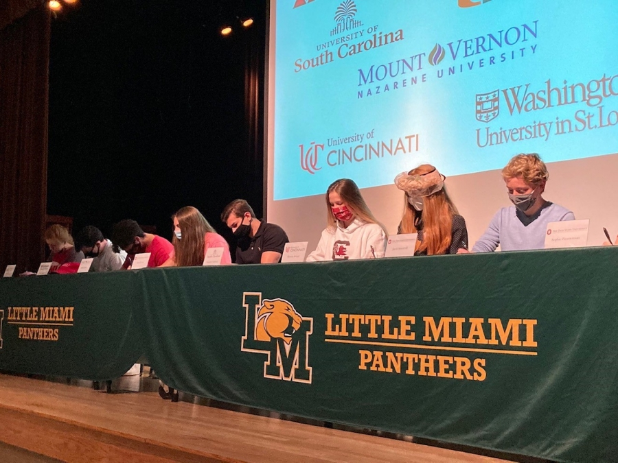Top Ten Academic Seniors signing their college commitments