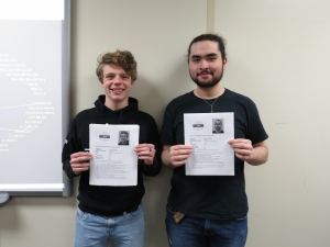 Photo of students holding certificates