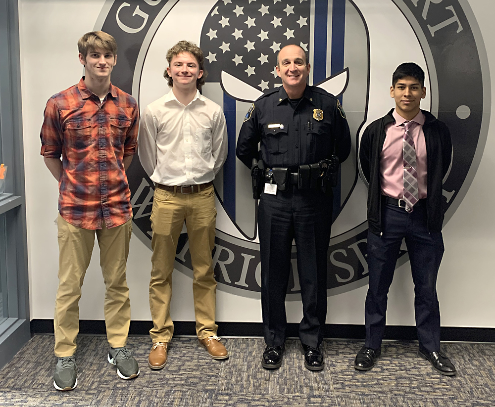 photo of students and officer