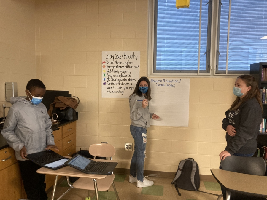 Students discuss children, education and social justice issues.