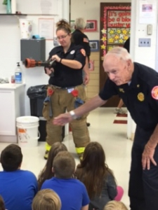 Photo of fire chief with students