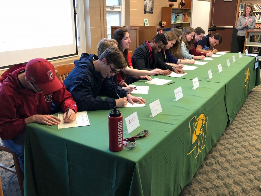 Photo of students signing